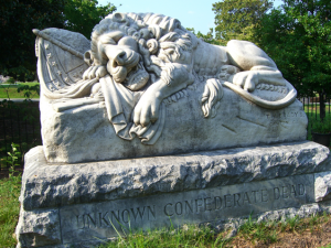 The lion of the confederacy, a stone monument guarding the haunted Oakland Cemetery. The cemetery is rumored to be haunted by Union and Confederate ghosts alike